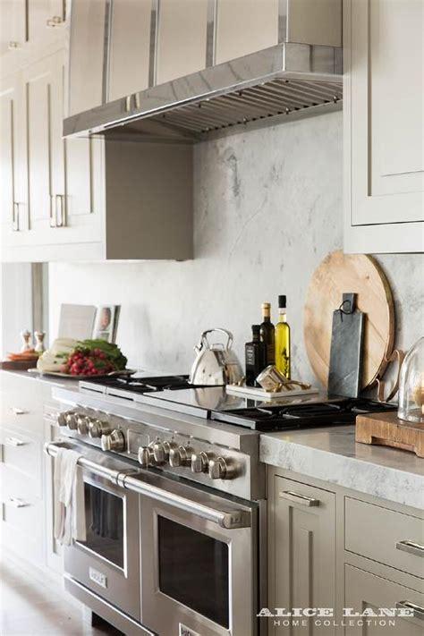 light gray kitchen cabinets light grey kitchen cabinets with marble slab backsplash