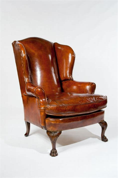 pair of carved and upholstered mahogany wing antique antique leather upholstered wing chair antiques
