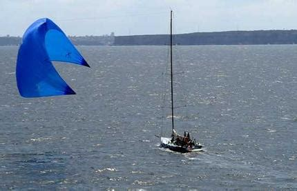 Sailing Boat With Kite by Skipper Hopes Mighty Kite Will Put The Wind Up Bigger