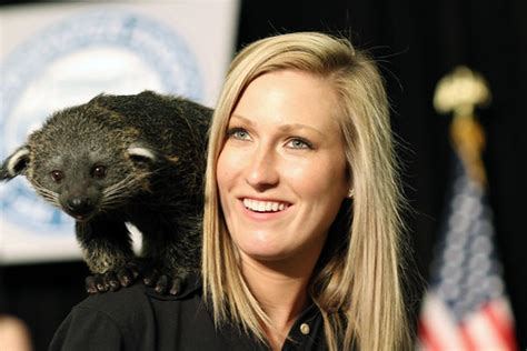 Jack Hanna's assistant holding a bearcat | Photo by ...