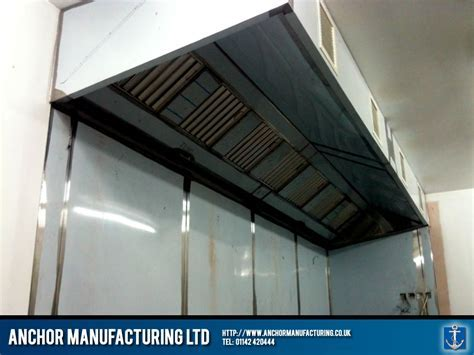 Kitchen canopy hood with steel wall cladding.   Anchor