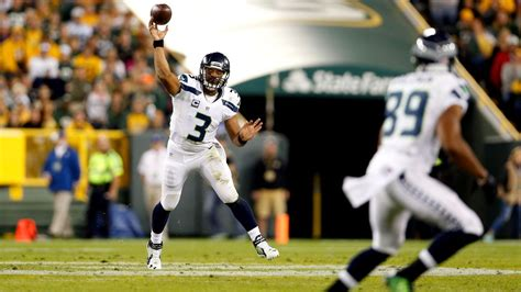 russell wilson  playing   qb