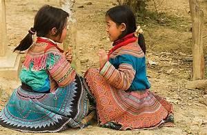 Flower Hmong schoolgirls playing in Cau Son near Bac Ha ...