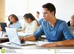 Male High School Student Using Laptop In Class Stock Photo ...