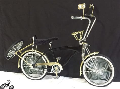 gold forks and deluxe lowrider bicycle