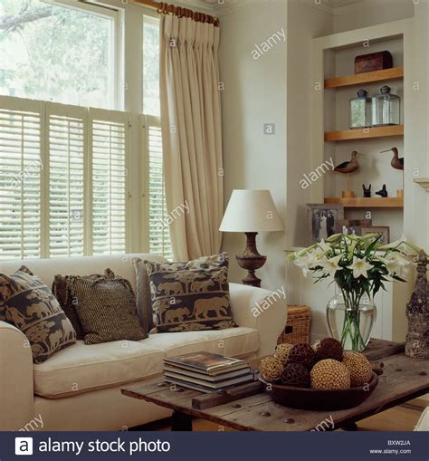curtains and plantation shutters on window above