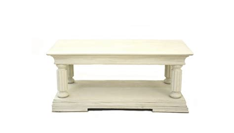 The circular top with glass insert, atop a narrow fluted frieze with patera carvings, raised on four squared tapering legs. French Empire Coffee Table 1200 x 600mm (Oatmeal)