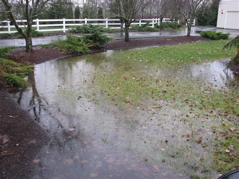 backyard flooding problems drains french drains surface drains central oklahoma sprinkler systems sprinkler repair