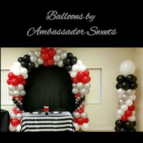 black white red  silver balloon arch  columns