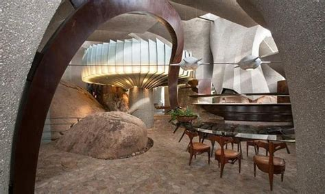 Cave Like Modern House Design Boundlessly Blending with