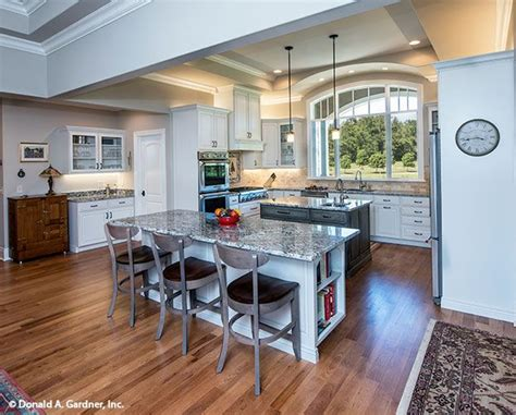 kitchen  completely open   islands   front facing window  chesnee home plan