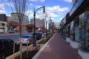 sidewalk shows tension  people  trees