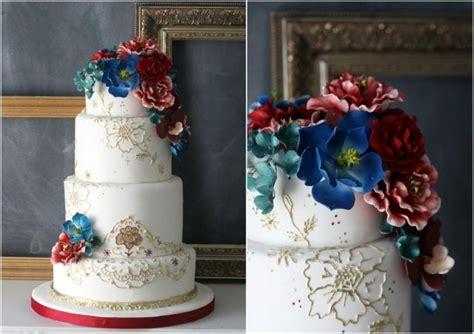 delightful wedding cakes  cascading florals