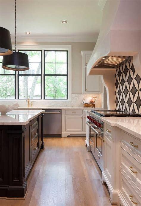 white kitchen with black island white kitchen with black island and white marble