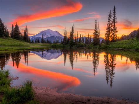 tipsoo lake  washington sunset mountain snow forest sky