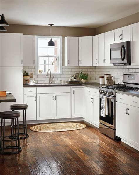lowes kitchen cabinets white now at lowe s arcadia collection streamlined 7241