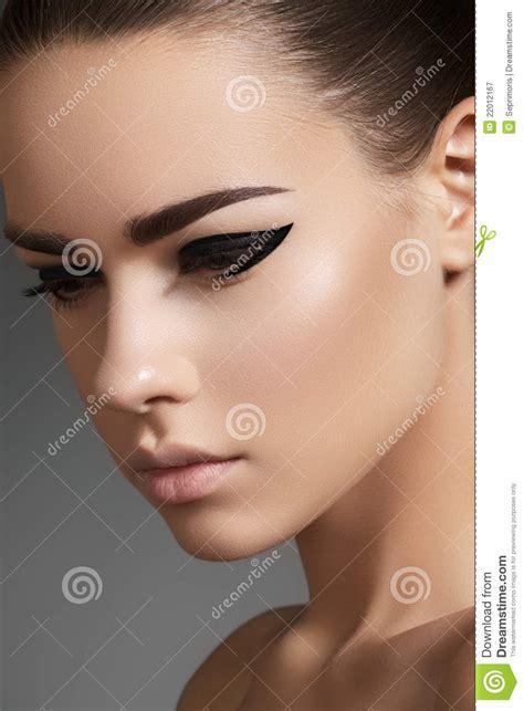 beautiful model face  fashion eyeliner   royalty  stock photography image