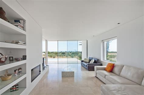 minimalist white house  glass walkway  olive grove