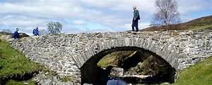 A Person Walking Over A Wade Bridge On The Corrieyairack