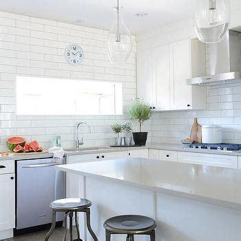 gray kitchen island  gold countertops transitional
