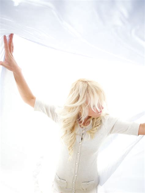 Fileblond Woman In White Clothes In A White Backgroundjpg