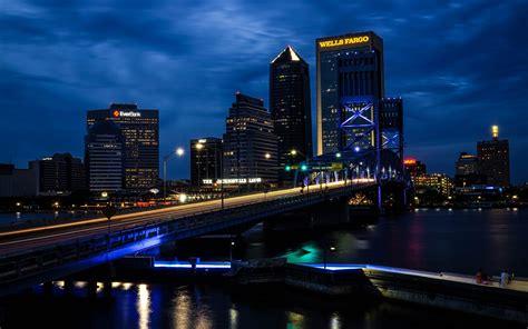 city cityscape bridge skyscraper night lights clouds