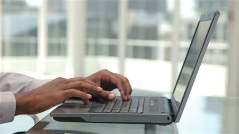 Closeup Of Woman Hand Typing On Laptop Keyboard With Mouse