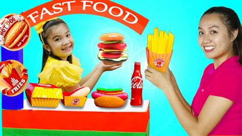 Hana Pretend Play Selling Fast Food Toys At Her Cardboard