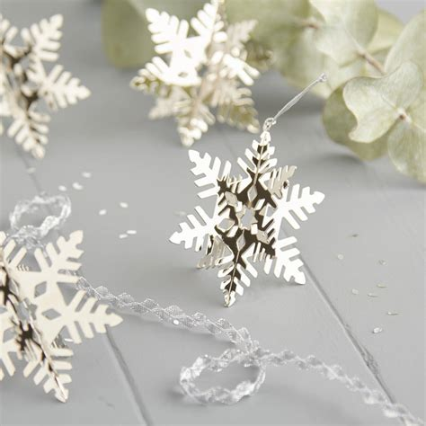 silver snowflake christmas decorations by the christmas