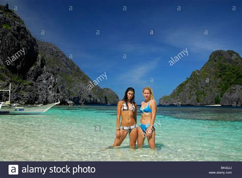 Young girls on the beach in El Nido area, Palawan ...