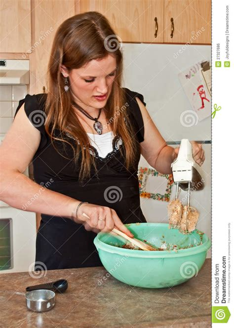 young woman baking cookies  mixer stock photo image