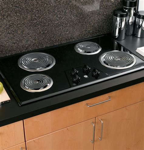 ge jpbkbb  electric cooktop   coil elements removable drip bowls upfront controls