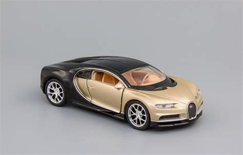 Bugatti does not build cars for going places. Bugatti Chiron 2016 Gold/Black
