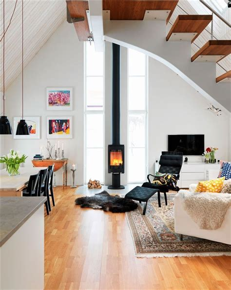 A sleek scandinavian morso wood stove replaced the previous unit, which had been situated so that its stovepipe blocked views from the kitchen and dining room. Love the wood burning stove | Wood burning stoves living room, Living room scandinavian, Modern ...