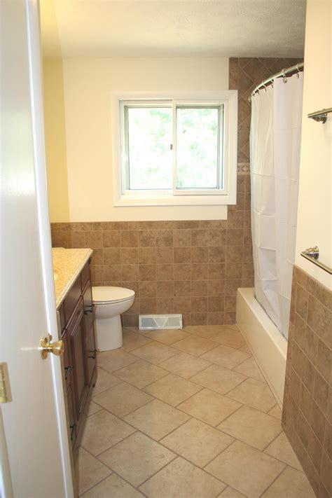 Tiles In Bathroom by Nest Homes Construction Floor And Wall Tile Designs