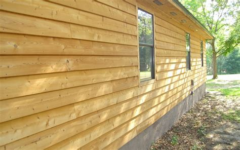 eco friendly composite siding  arm river builders