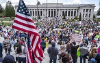 Demonstrators rally in Olympia against Washington's ...