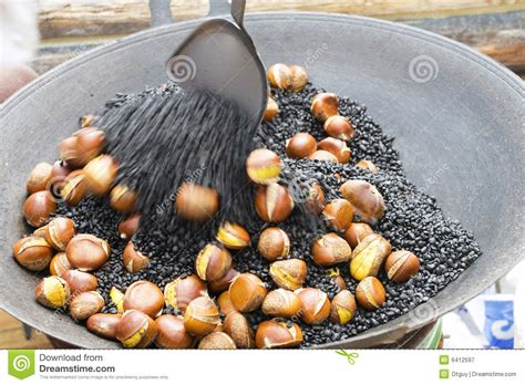 Roasting Chestnuts In The Pan Royalty Free Stock