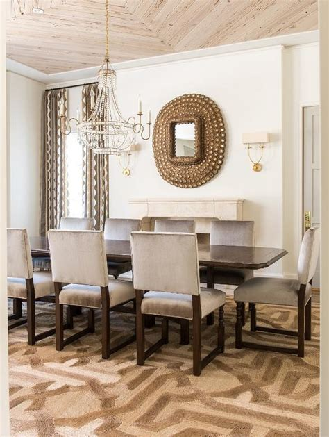 Brown and Gray Dining Room with Peacock Mirror Over Fireplace Transitional Dining Room