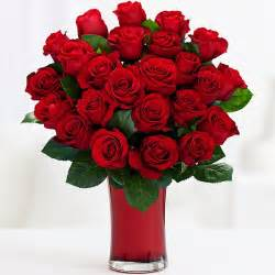 one dozen stemmed roses and other flowers