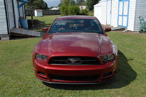 ruby red metallic  ford mustang   miles  sale