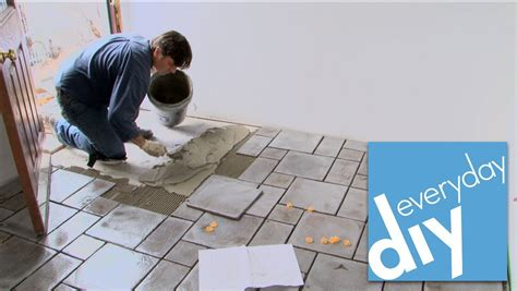 how to put flooring how to install a tile floor buildipedia diy youtube