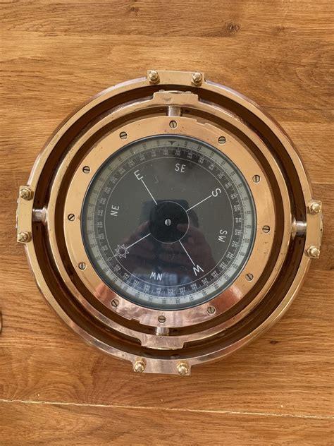 large oak table  electro compass  portholes brixham steam packet