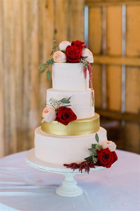 romantic white wedding cake  burgundy flowers