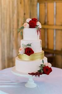 white wedding cake with burgundy flowers