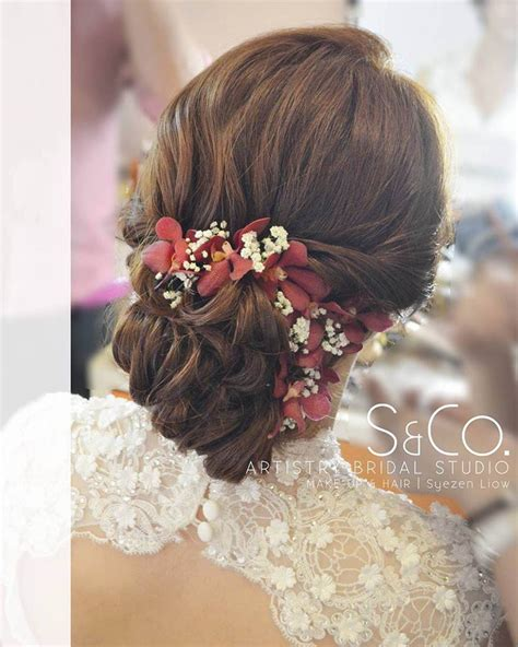 engaging wedding hairstyle  fresh flowers