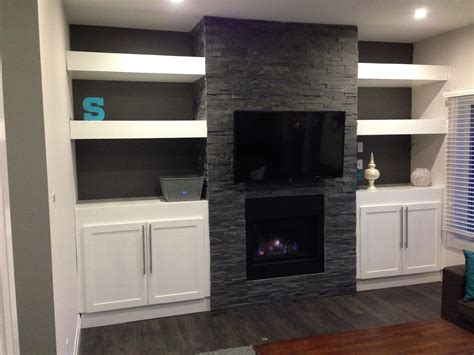 diy fireplace update with built in shelves on each my diy fireplace with built in cabinets and floating