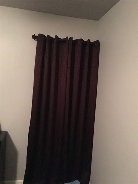 curtain for a window next to a wall
