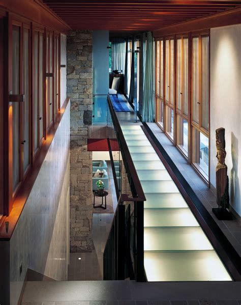 beautiful stone  wood house  indoor swimming pool  central focal point idesignarch
