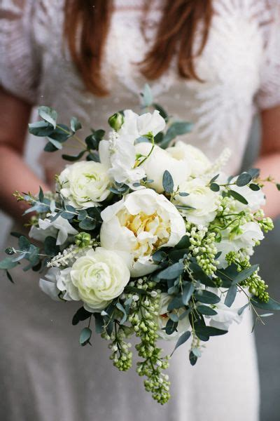 white peonies ranunculus  eucalyptus wedding bouquet